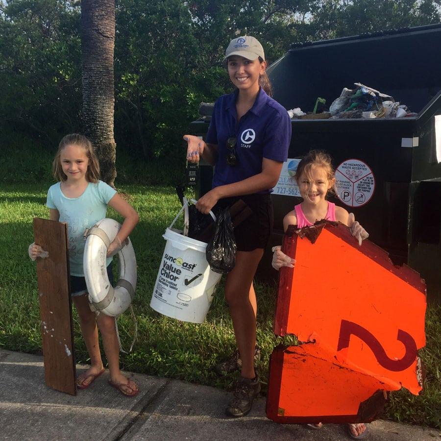collecting trash and debris at coastal cleanup