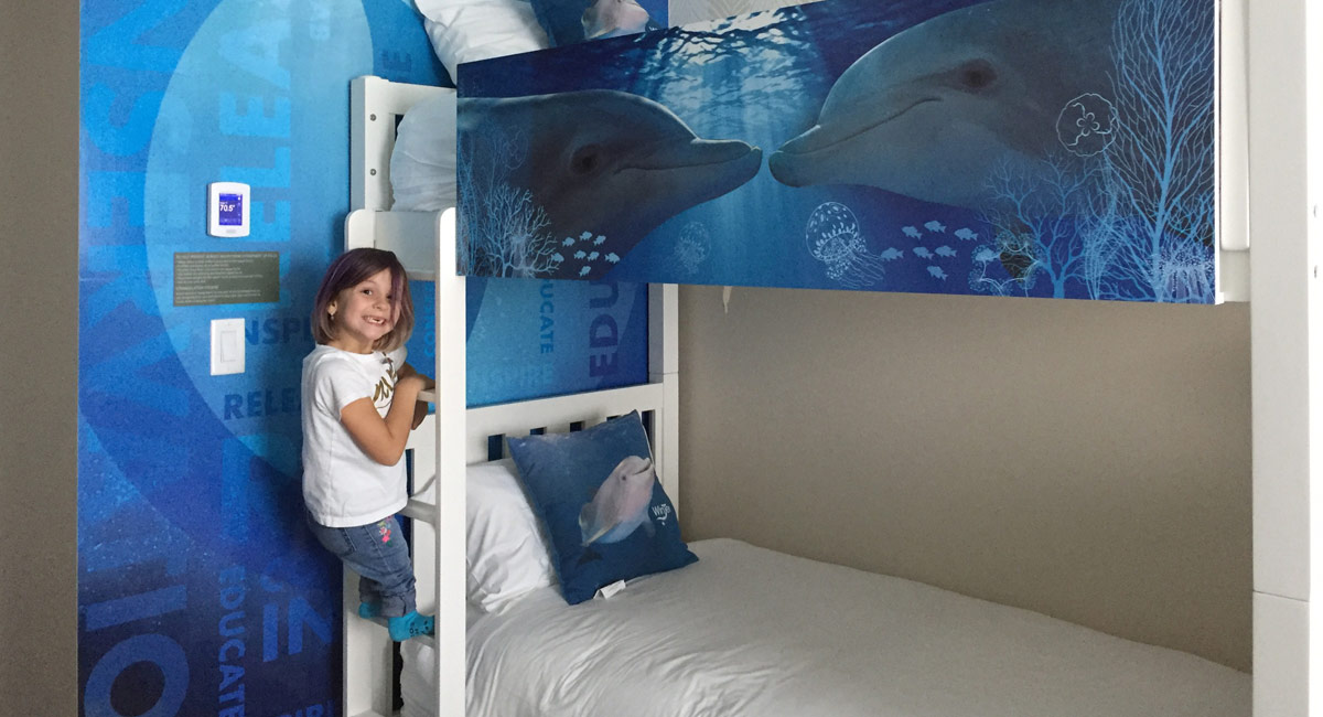 seven-year-old at Winter and Hope themed dolphin room at Wyndham Grand Clearwater Beach.