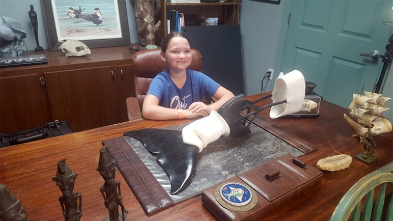 Leya with Winter the dolphin's prosthetic tail