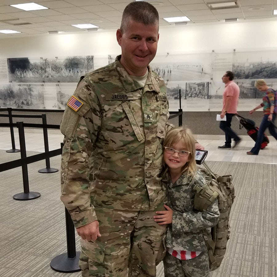 army dad with daughter at airport