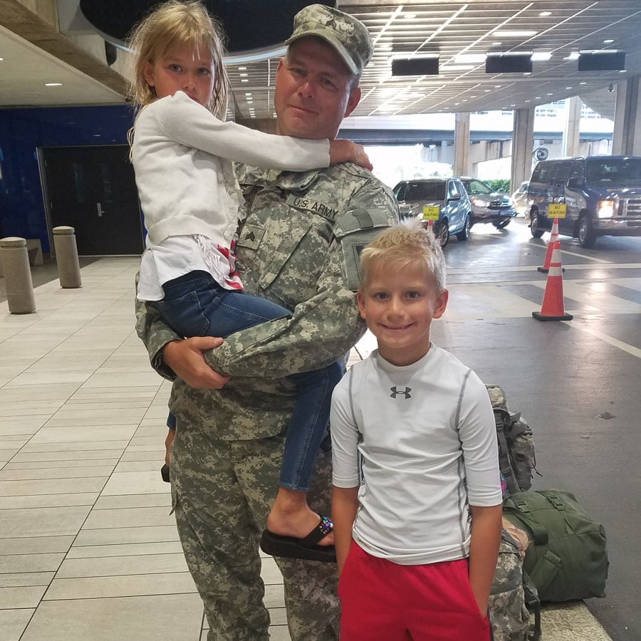 army family at airport
