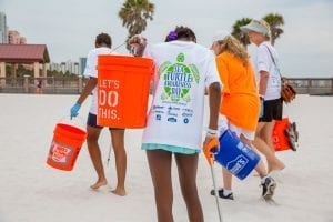 Group cleaning up the beach during Sea Turtle Awareness Day