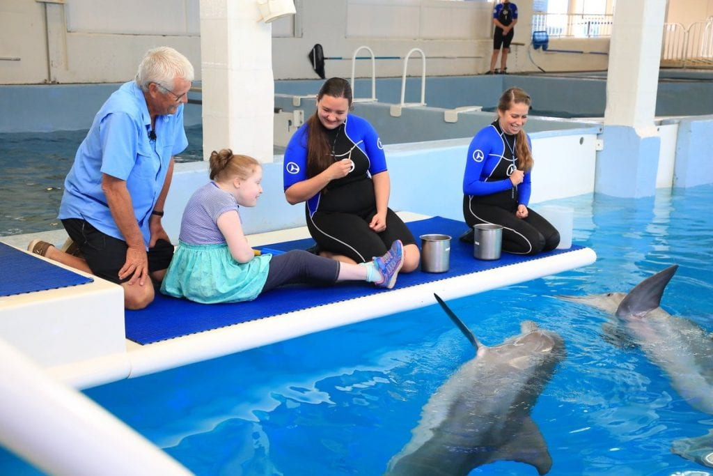 Jim and Grace Savage with dolphins