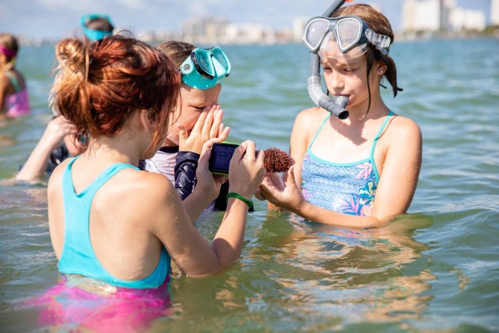 Group of girls snorkeling at CMA Summer Camp