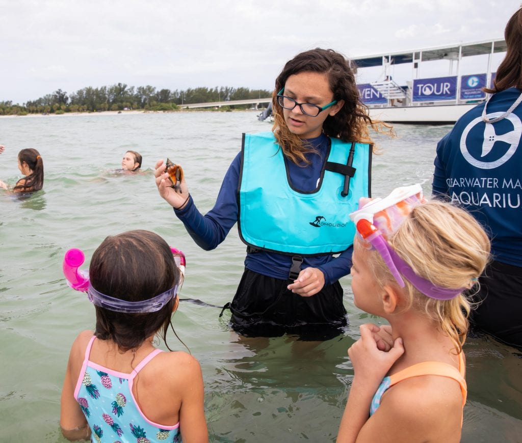 CMA Summer Camp Instructor Teaching Campers While Snorkeling
