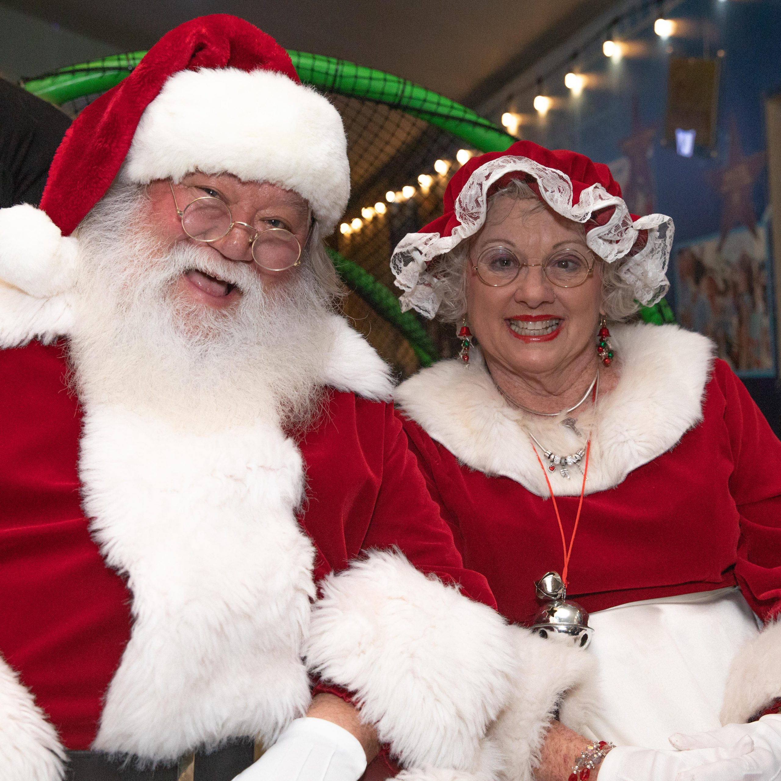 Santa and Mrs. Clause smiling
