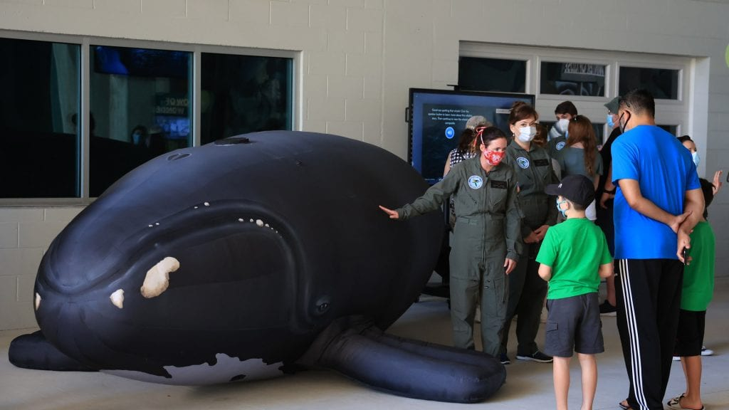 Whale researchers with guests